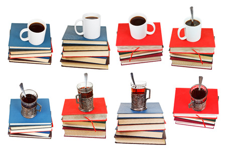 set from stacks of books with cup of coffee or tea on top isolated on white background photo