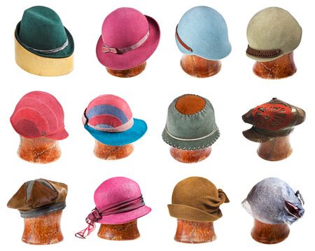 set of ladies felt hats on wooden hat block isolated on white background photo
