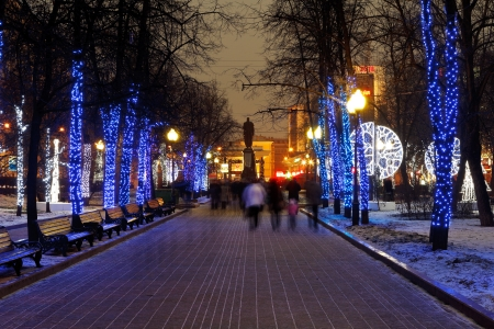 MOSCOW, RUSSIA - JANUARY 3, 2014: people walking on Moscow Clear Ponds boulevard with christmas night illumination. More than 4 thousand trees in urban center were decorated with garlands