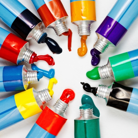 many multicolored tubes with squeezed watercolors photo