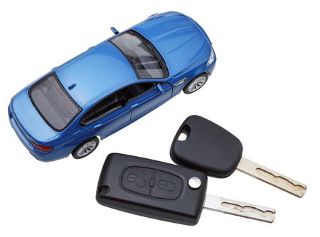 two on top: above view of two vehicle keys and model car isolated on white background Stock Photo