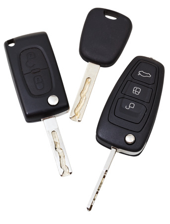top view of three vehicle keys isolated on white background photo