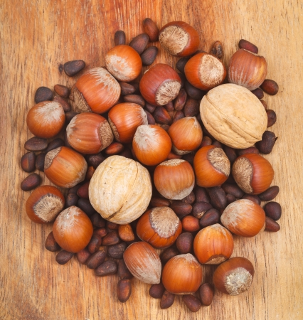 avellan: many dried nuts on wooden board Stock Photo