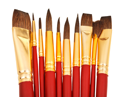 rigger: several watercolor paintbrushes close up isolated on white background