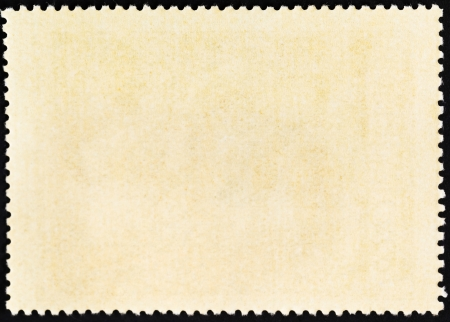 background from reverse side of used postage stamp photo