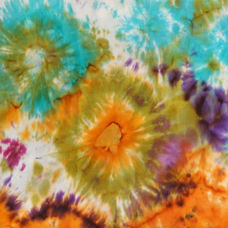 abstract stain pattern of painted silk batik on handmade scarf photo