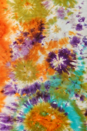 abstract stained pattern of painted silk batik on handmade scarf photo