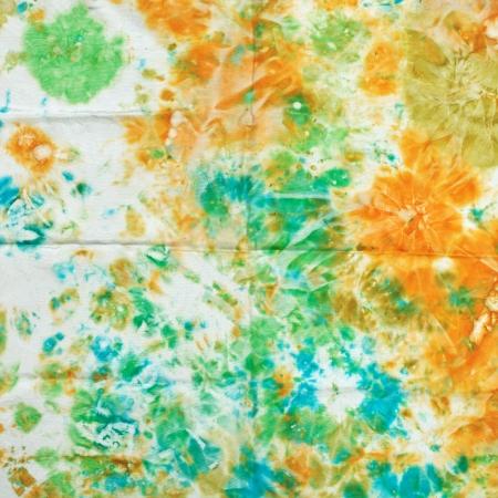 nodular: abstract nodular green and orange pattern of painted silk batik on handmade scarf