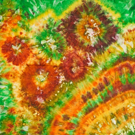 abstract bright floral pattern of painted silk batik on handmade scarf photo
