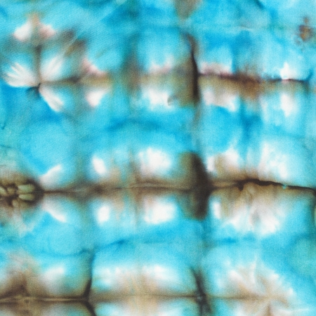 abstract blue cells pattern of painted silk batik on handmade scarf photo
