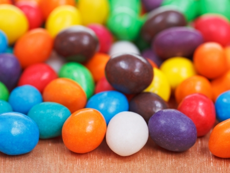 comfit: many multi-colored chocolate candy dragees close up Stock Photo