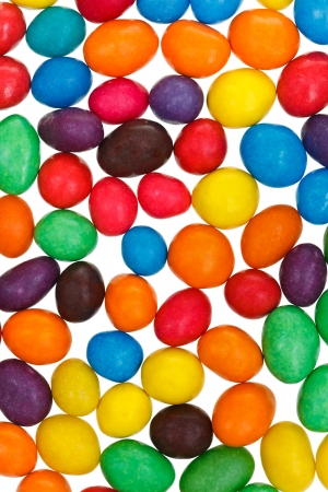 multi-colored chocolate candy dragees isolated on white background photo