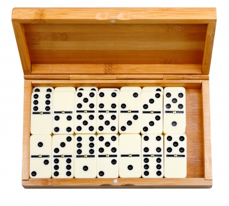 set of dominoes in bamboo box isolated on white background photo