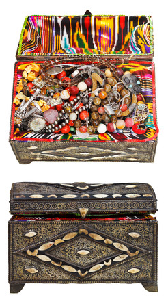 set of ancient decorated treasure chests with antique jewelry isolated on white background photo