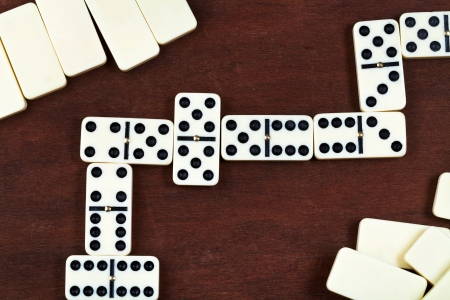 line of play in domino game on wooden table photo
