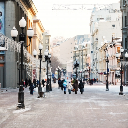 MOSCOW, RUSSIA - JANUARY 19, 2014: people walk on Arbat street in Moscow. Arbat has existed since the 15th century, it is pedestrian street about one km long in historical centre of Moscow