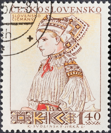 CZECHOSLOVAKIA- CIRCA 1956: A postage stamp printed in the Czechoslovakia shows portrait of young woman in Slovenian (Cicmany) national costume, circa 1956