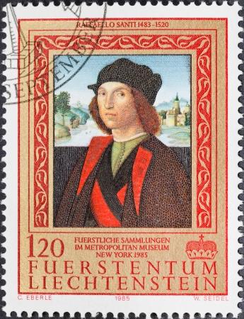 LIECHTENSTEIN - CIRCA 1985: A postage stamp printed in the Liechtenstein shows portrait of man by Raffaello Santi from Liechtenstein Museum Vienna during exposition in Metropolitan Museum NY, circa 1985 Editorial