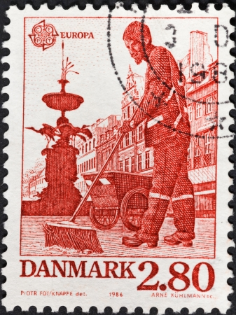 DENMARK - CIRCA 1986: A postage stamp printed in the Denmark shows street cleaner near Stork Fountain on Amager Square of Copenhagen, circa 1986