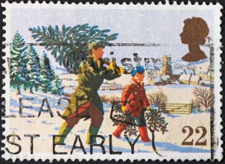 UNITED KINGDOM - CIRCA 1990: A postage stamp printed in the United Kingdom shows Fetching the Christmas Tree for Christmas, circa 1990