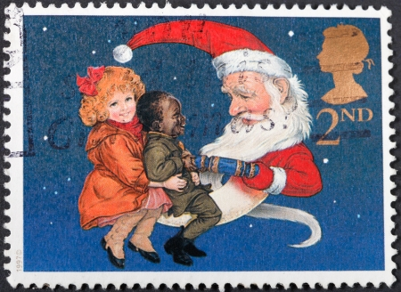 UNITED KINGDOM - CIRCA 1997: A postage stamp printed in the United Kingdom shows Children and Father Christmas pulling a Christmas Cracker , circa 1997