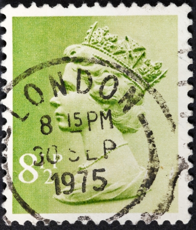 UNITED KINGDOM - CIRCA 1975: A postage stamp printed in the United Kingdom shows Queen Elizabeth on light green, circa 1975