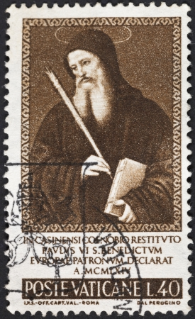 VATICAN - CIRCA 1965: A postage stamp printed in the Vatican shows patron Saint Benedict from paining Pietro Vannucci Perugino, circa 1965