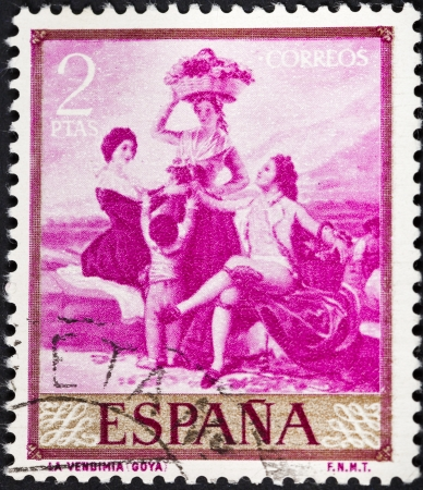 SPAIN - CIRCA 1958: A postage stamp printed in the Spain shows Goya painting Autumn or The Grape Harvest, circa 1958