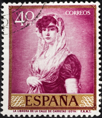 SPAIN - CIRCA 1958: A postage stamp printed in the Spain shows Goya painting Young Lady Wearing a Mantilla and Basquina, circa 1958