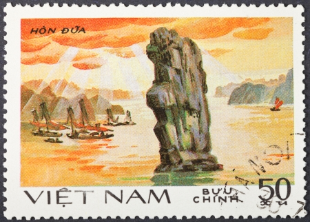 hon: SOCIALIST REPUBLIC OF VIETNAM - CIRCA 1984: A postage stamp printed in the Vietnam shows natural scenery of UNESCO World Heritage Chopstick Island (Hon Dua) at Ha Long bay, circa 1984