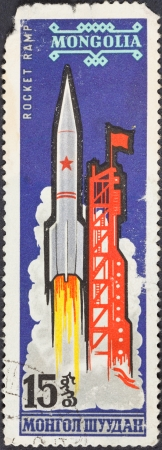 vostok: MONGOLIA - CIRCA 1963: A postage stamp printed in the Mongolia shows launch of carrier rocket Vostok L, circa 1963