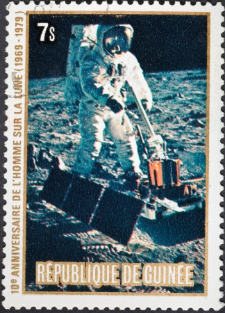 REPUBLIC OF GUINEA - CIRCA 1979: A postage stamp printed in the Republic of Guinea shows the Apollo 11 Moon Landing and Armstrong first step on The Moon surface, circa 1979