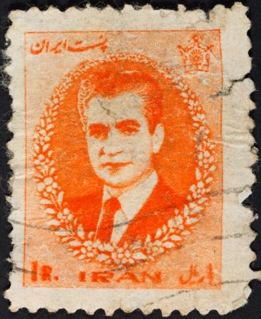 shah: IRAN - CIRCA 1966: A postage stamp printed in the Iran shows Mohammad Reza Shah Pahlavi, Shah of Persia, circa 1966