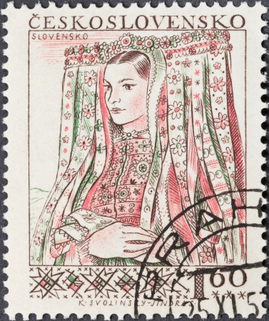 czechoslovakia: CZECHOSLOVAKIA- CIRCA 1956: A postage stamp printed in the Czechoslovakia shows portrait of young woman in Slovenian national costume, circa 1956