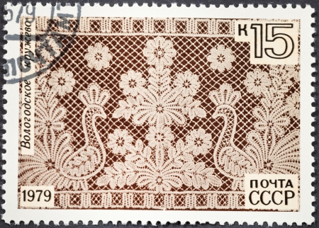 weaved: RUSSIA - CIRCA 1979: A postage stamp printed in the Russia shows old Russian Vologda lace - kind of Russian lace weaved by wooden bobbins, circa 1979