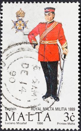 militia: MALTA - CIRCA 1990: A stamp printed in Malta shows full dress uniform of captain royal malta militia in 1889, circa 1990