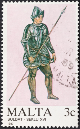 MALTA - CIRCA 1987: A stamp printed in Malta shows full dress uniform of maltese military uniform in 16th century, circa 1987