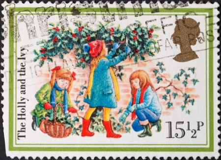 UNITED KINGDOM - CIRCA 1982: A postage stamp printed in the United Kingdom shows Christmas scenery The Holly and the Ivy , circa 1982