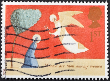 thou: UNITED KINGDOM - CIRCA 1996: A postage stamp printed in the United Kingdom shows Christmas scenery The Annunciation - blessed art thou among women , circa 1996