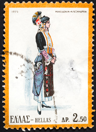 GREECE - CIRCA 1973: A postage stamp printed in the Greece shows woman in Greek national folk dress, circa 1973