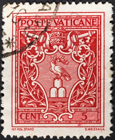 catholicity: VATICAN - CIRCA 1940: A postage stamp printed in the Vatican shows Pope Pius XII symbol dove with olive branch, circa 1940 Editorial