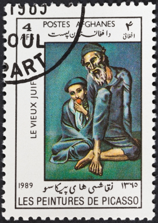 pablo: DEMOCRATIC REPUBLIC of AFGHANISTAN - CIRCA 1989: A postage stamp printed in the Afghanistan shows Old Jew with a boy by Picasso, circa 1989 Editorial