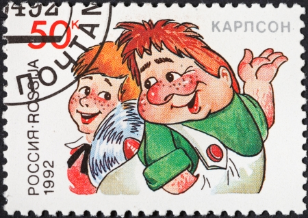 RUSSIA - CIRCA 1992: A postage stamp printed in the Russia shows Kid and Karlson characters of popular cartoons in USSR, circa 1992