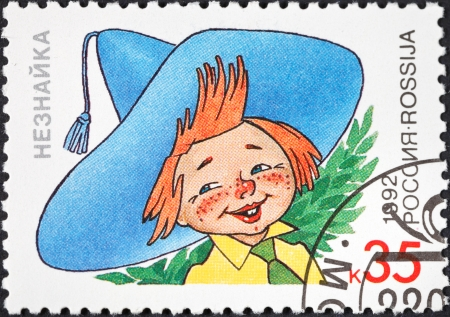 RUSSIA - CIRCA 1992: A postage stamp printed in the Russia shows Dunno (Neznaika) character of popular cartoons in USSR, circa 1992