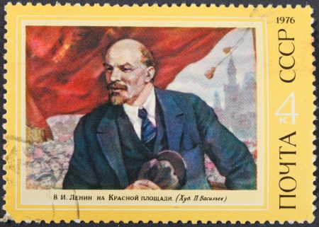 theorist: USSR - CIRCA 1976: A postage stamp printed in the USSR shows portrait of communist leader Lenin (Ulyanov) on meeting on Red Square, circa 1976