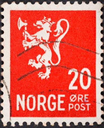 the monarchy: NORWAY - CIRCA 1940: A postage stamp printed in the Norway shows symbol of norwegian monarchy lion on red background, circa 1940