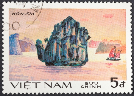 hon: SOCIALIST REPUBLIC OF VIETNAM - CIRCA 1984: A postage stamp printed in the Vietnam shows natural scenery of UNESCO World Heritage island Hon Am at Ha Long bay, circa 1984