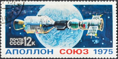 orbital: USSR - CIRCA 1975: A postage stamp printed in the USSR shows Apollo Soyuz Test Project - space docking of spaceships, circa 1975