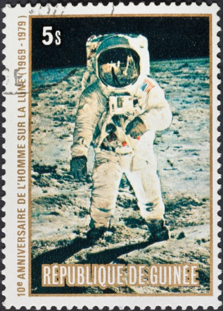 REPUBLIC OF GUINEA - CIRCA 1979: A postage stamp printed in the Republic of Guinea shows the Apollo 11 Moon Landing and Amstrong first step on The Moon surface, circa 1979