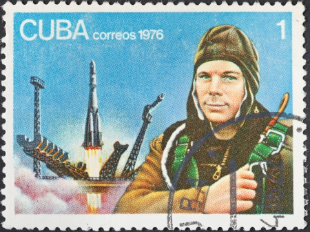 vostok: CUBA - CIRCA 1976: A postage stamp printed in the Cuba shows first astronaut Yuri Gagarin and Vostok launch, circa 1976